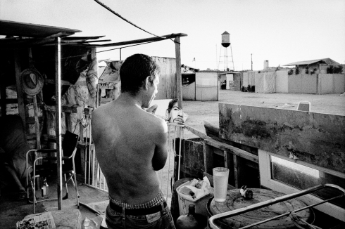 Jobless man at his shantytown home. Fresno, California.